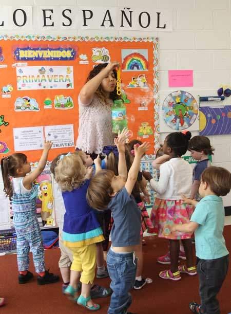 preschool kids in Spanish class